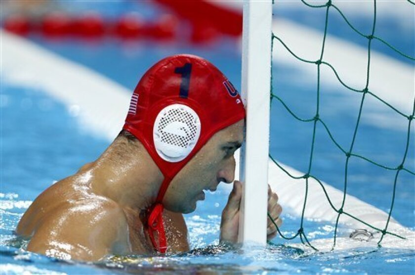 United States goalkeeper Merrill Moses reacts after Spain's Felipe Perrone Rocha scored a goal on him during a men's semifinal fifth to eighth place water polo match at the 2012 Summer Olympics, Friday, Aug. 10, 2012, in London. Spain won 8-7. (AP Photo/Julio Cortez)