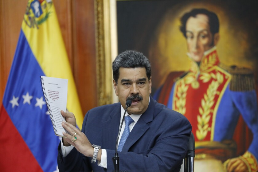 Venezuelan President Nicolas Maduro holds a news conference at Miraflores presidential palace in Caracas, Venezuela.