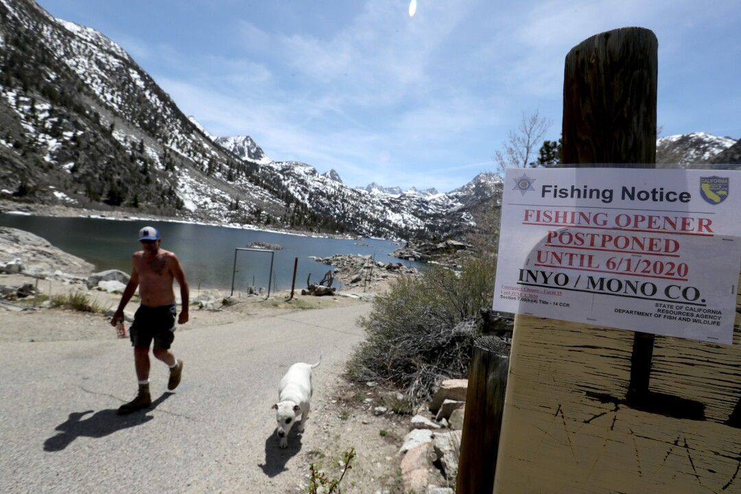Signs at Lake Sabrina proclaim the postponement of fishing season on May 7 in Bishop.
