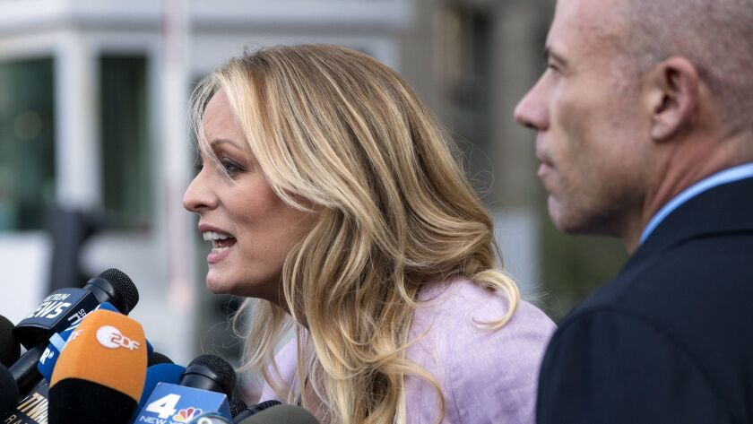 Adult film actress Stormy Daniels speaks outside federal court Monday, April 16, 2018, in New York,