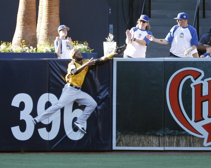 World's Manuel Margot makes a catch at the wall to prevent USA's Carson Kelly a home run in the sixth inning during the All-Star Futures Game at Petco Park in San Diego on Sunday.