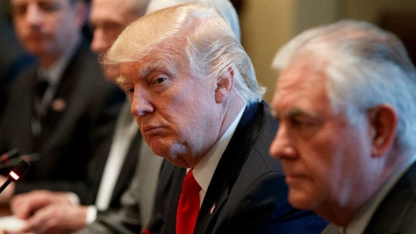 President Trump, left listens with Secretary of State Rex Tillerson to Iraqi Prime Minister Haider Abadi, not pictured, during a meeting at the White House on Monday.