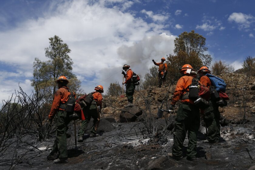 Inmate firefighters check for hotspots as they battle the Jerusalem fire near Lower Lake, Calif.