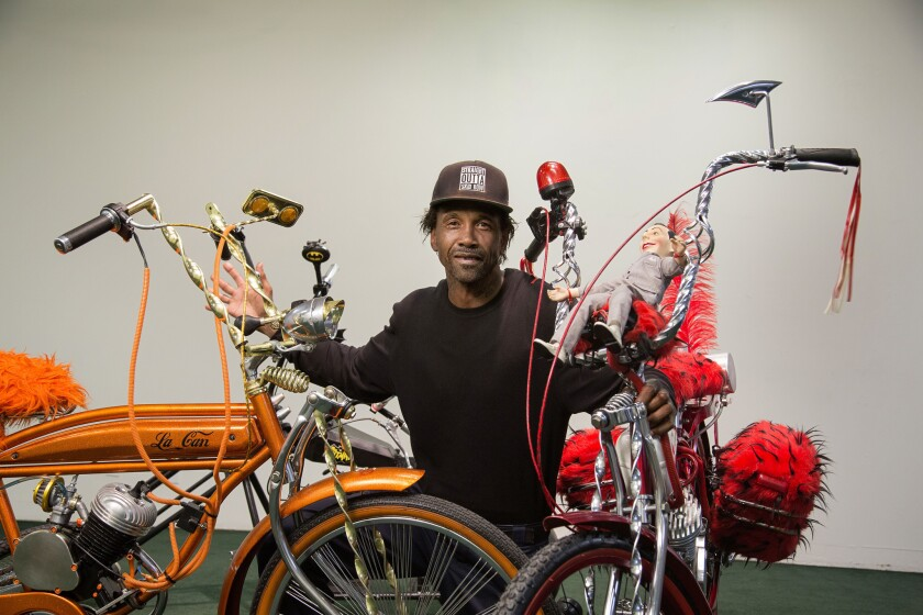 The activist known as General Dogon poses with his custom bikes at the Skid Row History Museum and Archive in downtown Los Angeles. The bikes are on display as part of a series of exhibitions that will chronicle the history of Skid Row.