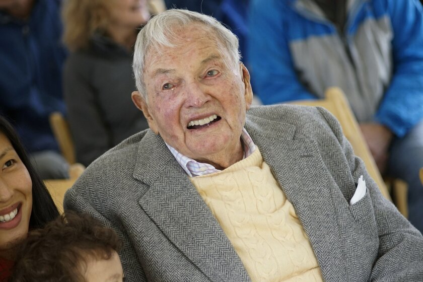 """David Rockefeller smiles as he greets family and friends at a ceremony, Friday, May 22, 2015, in Mount Desert, Maine, marking the gift of 1,000 acres of woodlands, streams, hiking trails and carriage roads abutting Acadia National Park. Rockefeller, the retired CEO of Chase Manhattan Bank and grandson of oil tycoon John Rockefeller Sr., is transferring family property at Little Long Pond in Seal Harbor to the Mount Desert Island & Garden Preserve, describing it as a """"gift to all the people of Maine."""" (AP Photo/Michael C. York)"""