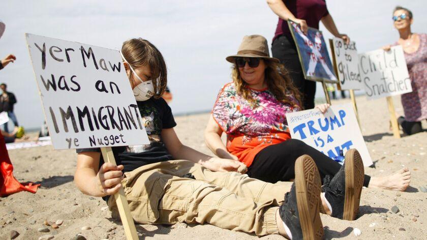 Protesters on a beach near Turnberry golf club, Scotland, Saturday, July 14, 2018. U.S. President Do