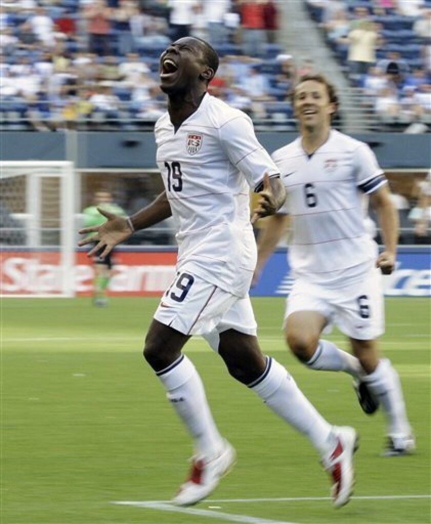 United States' Freddy Adu, left, celebrates with teammate Steve Cherundolo after scoring a goal against Grenada in the first half of a CONCACAF Gold Cup soccer match Saturday, July 4, 2009, at Qwest Field in Seattle. (AP Photo/Ted S. Warren)