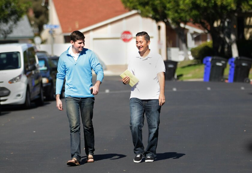 City council candidate Chris Cate, right, walked to the polling place in his Mira Mesa neighborhood with campaign manager James Hauser.
