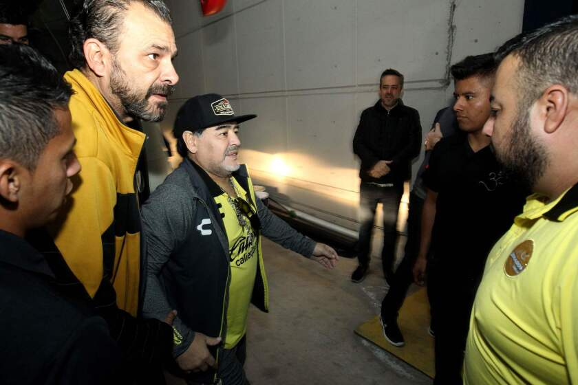 The coach of Mexican second division football team Dorados, Argentine Diego Armando Maradona, arrives for the second leg match of the final against Atletico San Luis, at the Alfonso Lastras Ramirez stadium in San Luis Potosi, Mexico, on December 2, 2018.