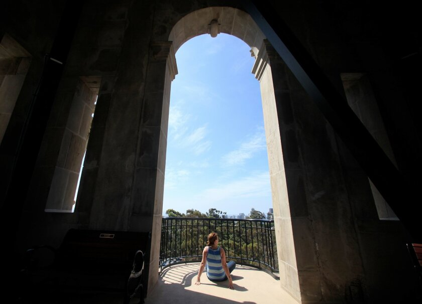 Desiree Koufman enjoys the view from atop the California Tower in Balboa Park which is now open for tours for the first time since 1935.