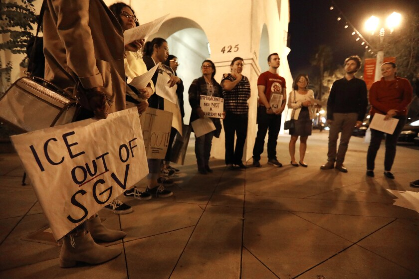 Advocacy groups rally in front of City Hall in San Gabriel to express their concern about the San Gabriel Police Department's working with Immigration and Customs Enforcement.