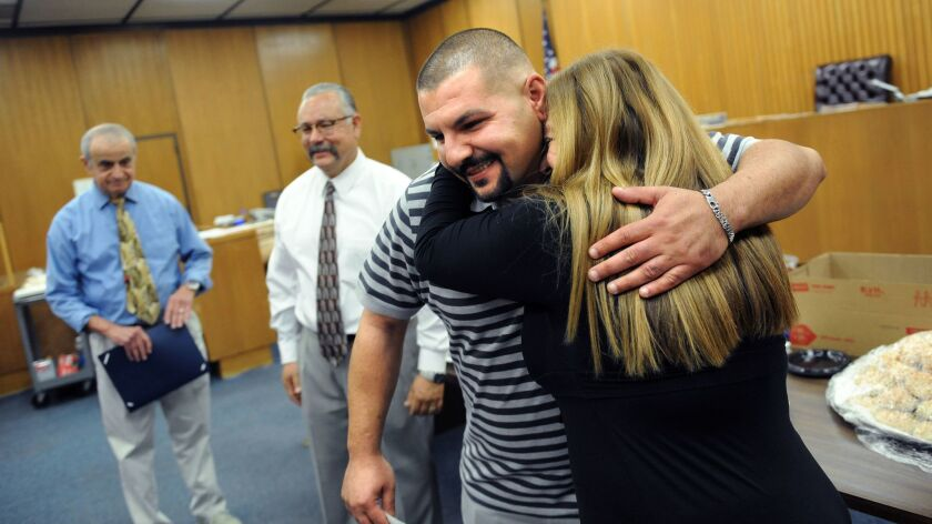 PASADENA, CALIFORNIA OCTOBER 29, 2015-Patrick Khachatoorian, 30, hugs Deputy District Attorney Marle