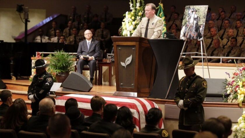 Los Angeles County Sheriff Jim McDonnell speaks as thousands gathered for the 2016 funeral of slain Los Angeles County Sheriff's Sgt. Steve Owen in Lancaster.