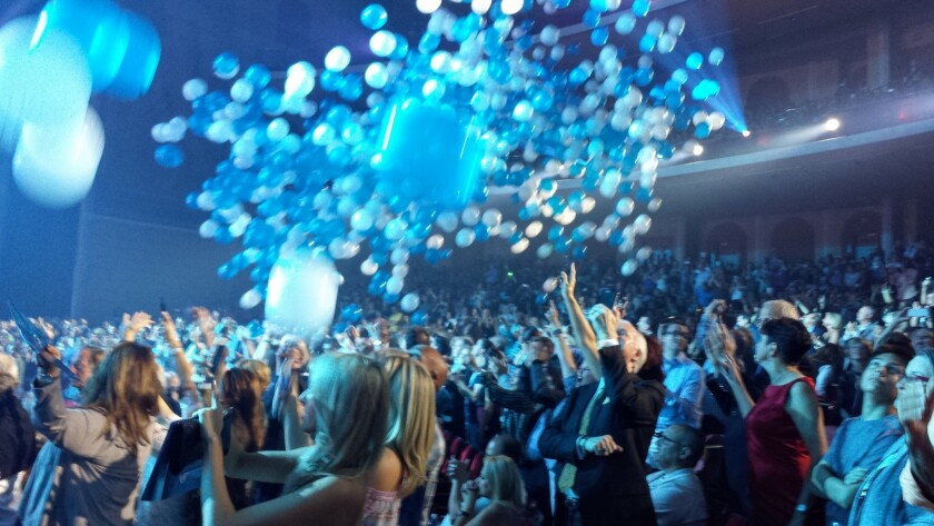 Balloons and confetti fall from rafters at the end of Celine Dion's Saturday show.