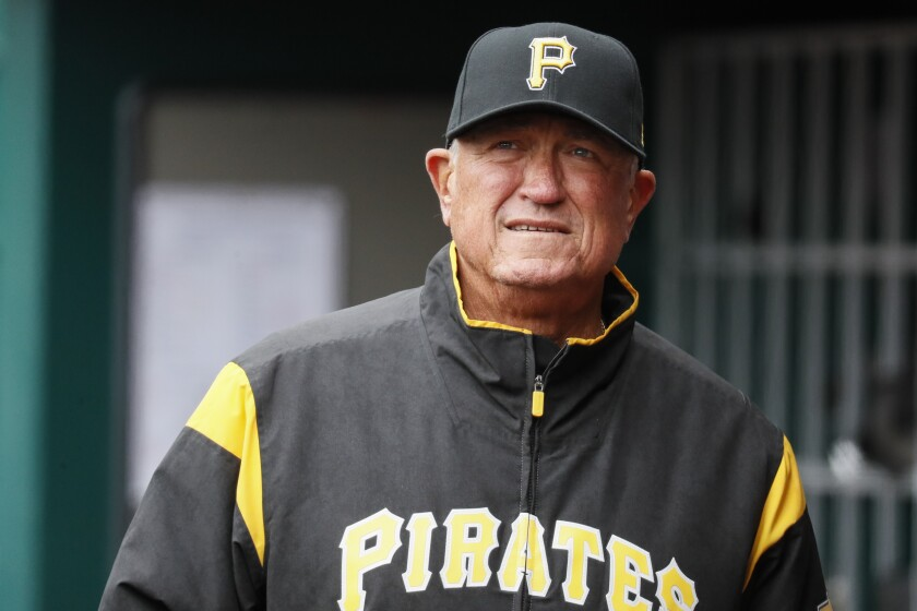 FILE - In this March 31, 2019, file photo, Pittsburgh Pirates manager Clint Hurdle walks through the dugout in the third inning of a baseball game against the Cincinnati Reds in Cincinnati. Hurdle hopes to return for what would be his 10th season as the Pirates' manager in 2020. He has two more years remaining on a deal that started with the 2018 season. (AP Photo/John Minchillo, File)