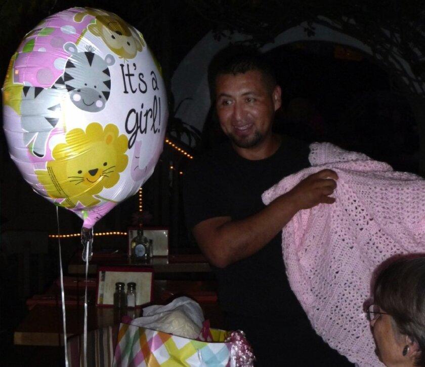 En Fuego's Rodrigo at the surprise baby shower.