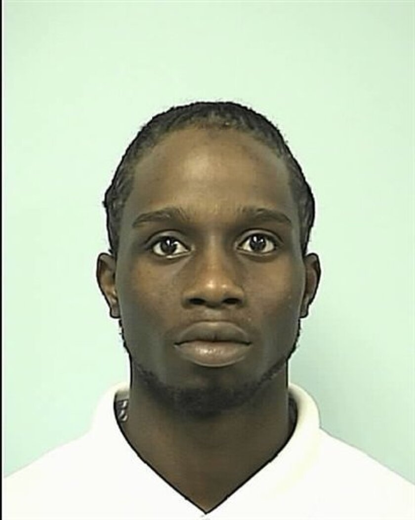 This photo released by Springfield Police Department shows a booking photo of Tamik J. Kirkland, 24. Law enforcement officials said Tamik Kirkland burst from a car trunk Saturday and opened fire on a state trooper and a Springfield police officer who'd pulled over the car. Police say Kirkland, 24, was hit several times when police fired back. Authorities had been looking for Kirkland since he escaped from a minimum security prison earlier in the week, where he'd been serving time on weapons convictions. (AP Photo/Springfield Police Department)