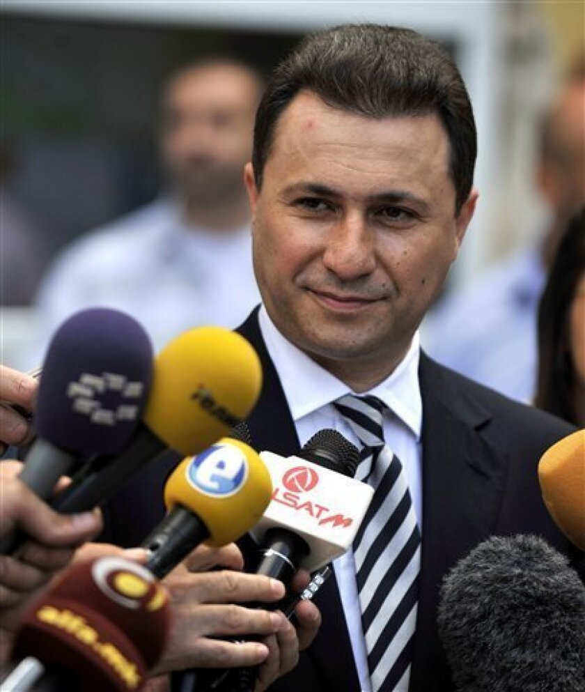 Macedonia's Conservative Prime Minister Nikola Gruevski talks to the media after casting his ballot, outside a polling station in Macedonia's capital Skopje, Sunday, June 5, 2011. Macedonians were voting Sunday in snap general elections called after months of bitter acrimony that has seen the opposition boycott parliament since the start of the year. (AP Photo/Boris Grdanoski)
