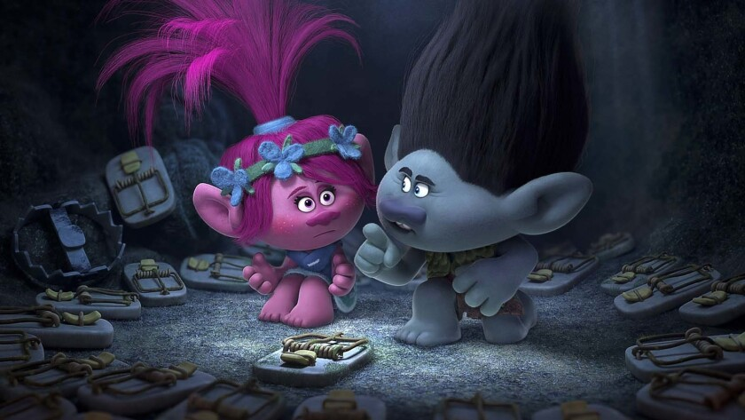 This image released by Dreamworks Animation shows characters Poppy, left, voiced by Anna Kendrick, a