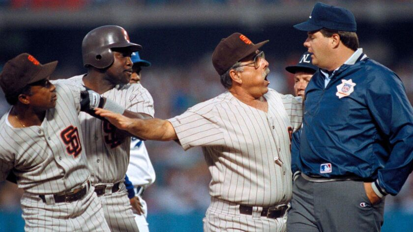 This Aug. 4, 1989 file photo shows San Diego Padres manager Jack McKeon arguing with third base umpire Jerry Layne as third base coach Sandy Alomar, left, restrains batter Tony Gwynn in the first inning against the Los Angeles Dodgers, at Dodger Stadium, Aug. 4, 1989.