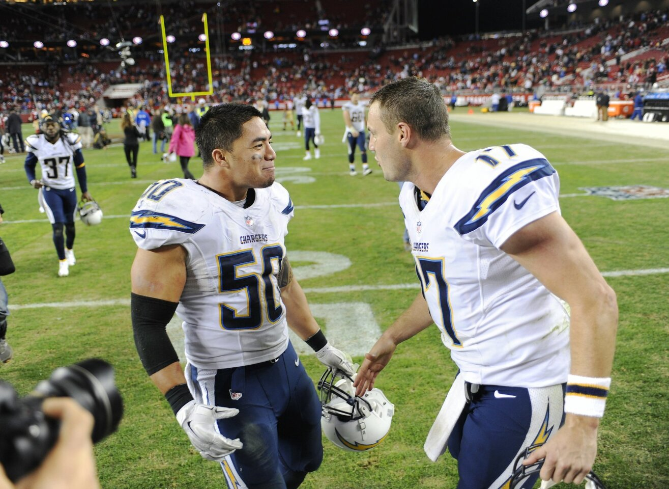 Chargers Manti Te'o and Philip Rivers celebrate win over 49ers.