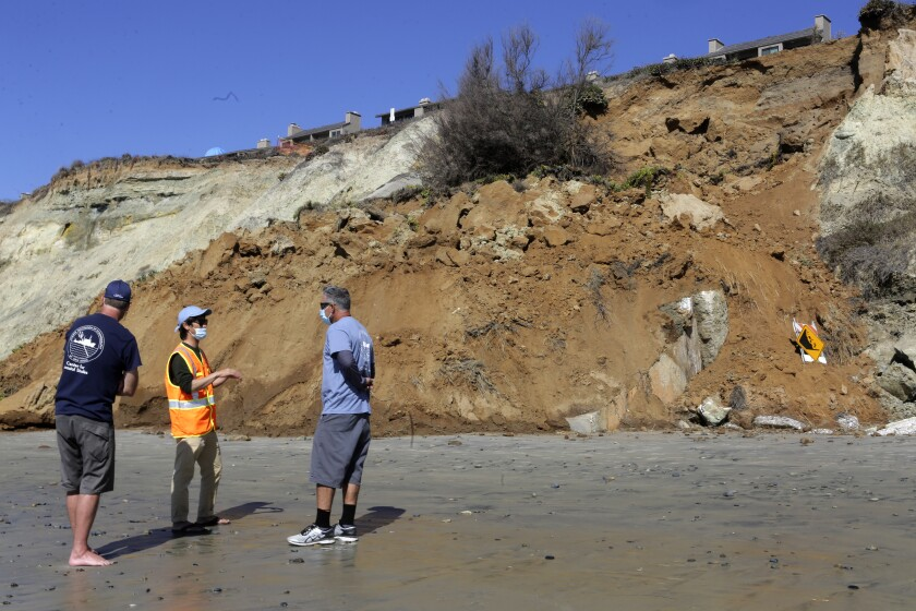 A crew from the Scripps Institution of Oceanography at UCSD gathers data Monday at a bluff that collapsed in Del Mar.
