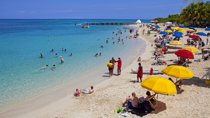 Doctor's Cave Beach on Montego Bay, Jamaica. The white sand is attractive, as is the $435 round-trip airfare from LAX.