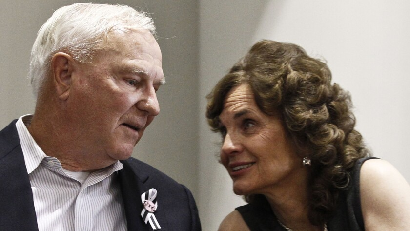 Bill Badger and his wife, Sallie Badger, at a 2012 news conference after the sentencing of Jared Loughner.