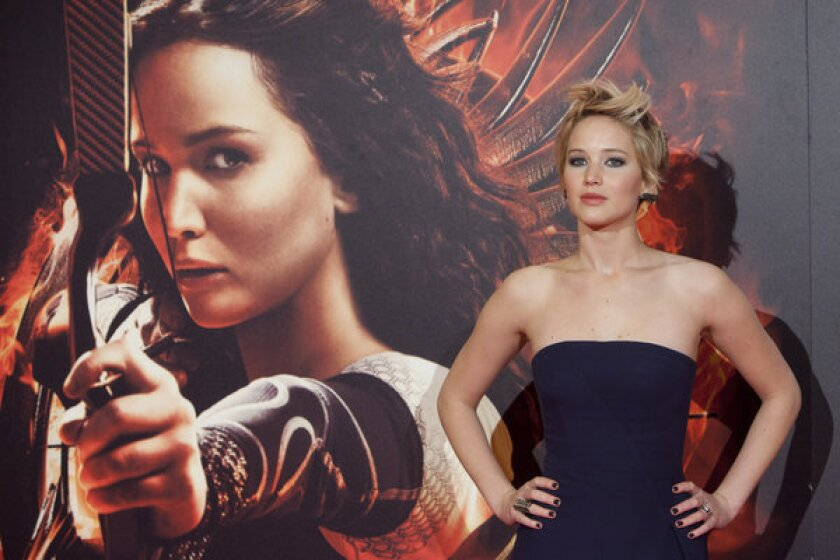 """Jennifer Lawrence poses for photographers during the Spanish premiere of the movie """"The Hunger Games: Catching Fire."""""""