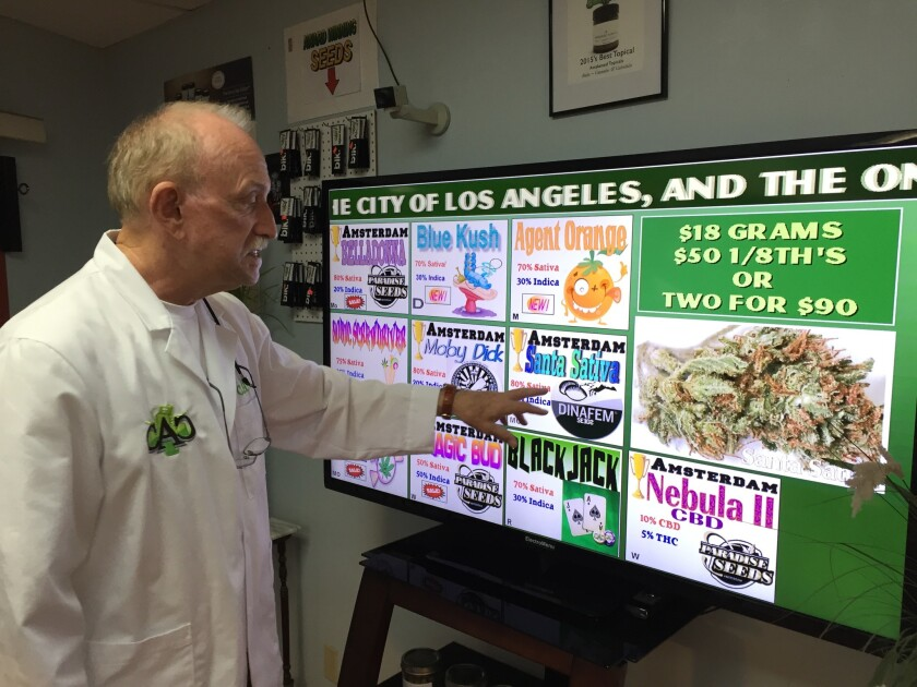 Now that California voters have legalized pot, Carl Clines of California Alternative Caregivers in Venice expects to expand his small dispensary or sell it and retire. Here, he points to his menu of strains, which he says are grown from seeds he obtains each year in Spain.