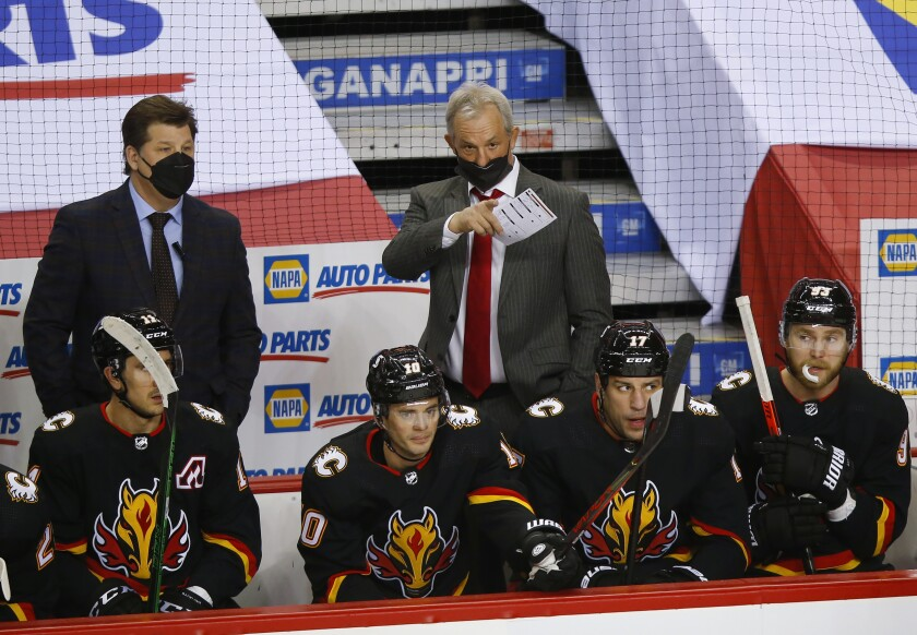 New Calgary Flames coach Darryl Sutter gives out instructions during the first period of the team's NHL hockey game against the Montreal Canadiens in Calgary, Alberta, Thursday, March 11, 2021. (Todd Korol/The Canadian Press via AP)