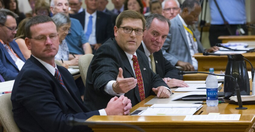 Department of Administration Secretary Scott Neitzel, second from left, speaks about the incentive deal for Taiwan-based Foxconn Technology Group before the Assembly Committee on Jobs and Economy, Thursday, Aug. 3, 2017, at the state Capitol in Madison, Wis.