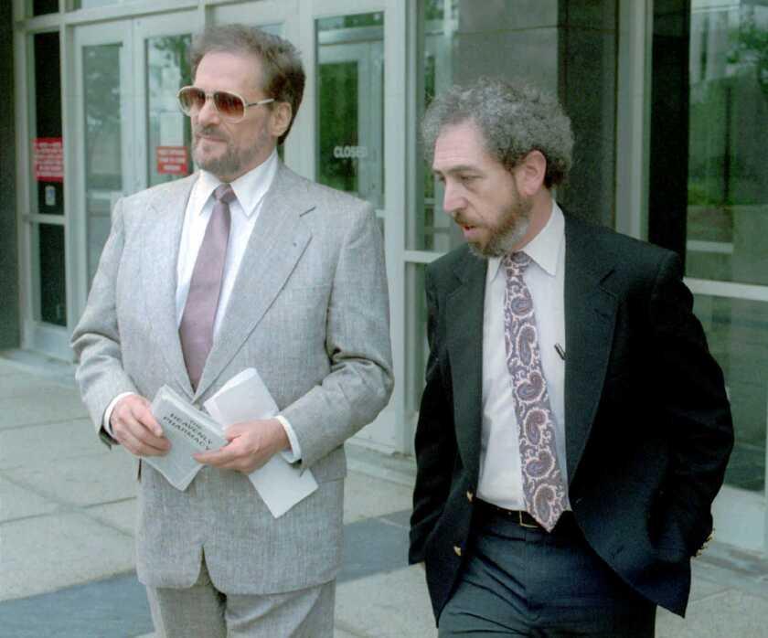 Tony Alamo, a Christian evangelist, left, leaves a federal court in Memphis in 1996. An Alamo-connected church has been ordered to pay $525 million to seven victims who alleged Alamo abused them.
