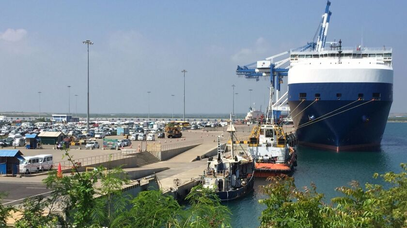 A car transporter docks at Hambantota port in Sri Lanka.