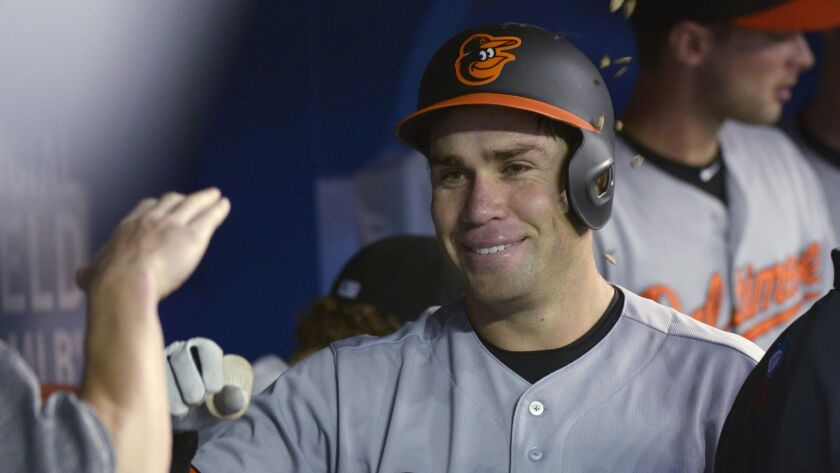 Baltimore Orioles' Austin Wynns celebrates in the dugout after hitting his first home run in the maj