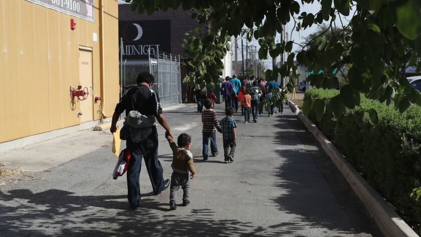 Central American immigrant families depart ICE custody, pending future immigration court hearings in Texas.