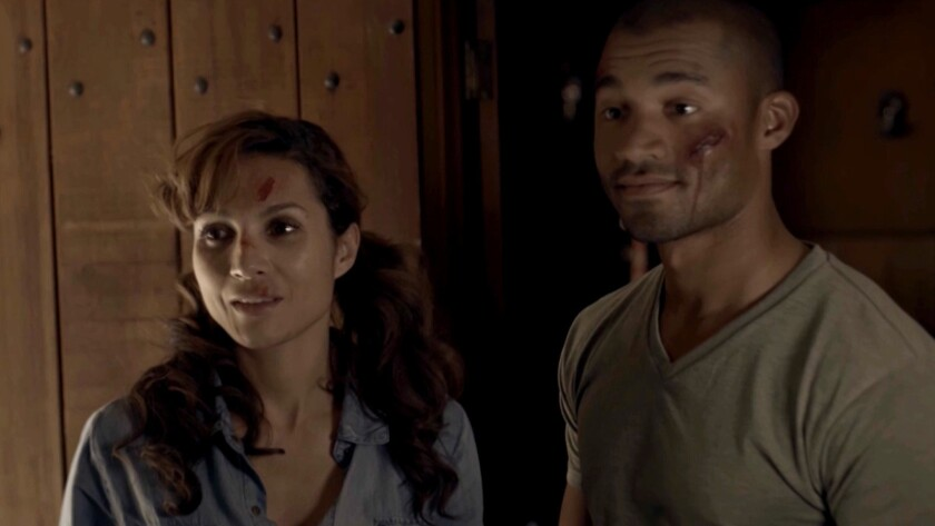 """Marem Hassler and Michael Marcel in the movie """"Edge of Isolation."""""""