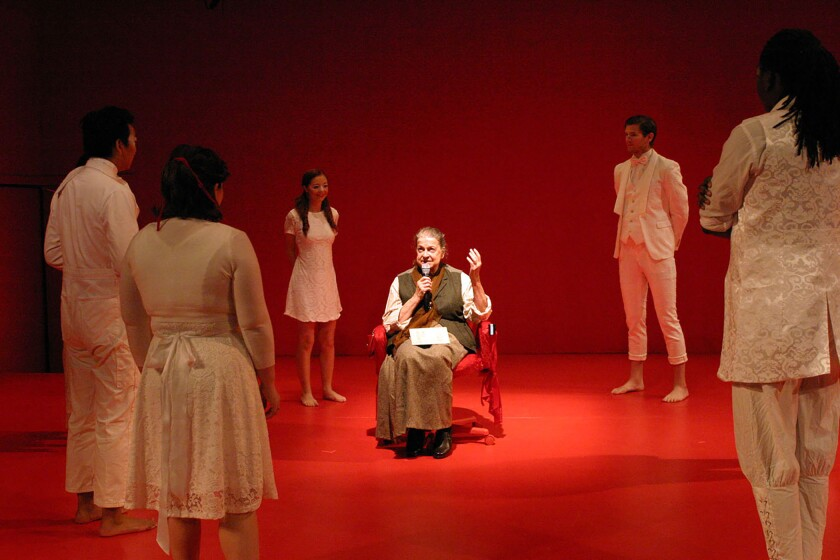 """Jacque Lynn Colton, seated as Gertrude Stein and surrounded by, clockwise from front left, Ashlee Dutson, Aaron Jung, Chloe Haven, P.T. Mahoney and Kyle G. Fuller in """"In Circles,"""" directed by David Schweizer at the Odyssey Theatre."""