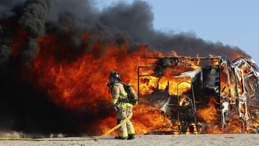 Firefighters respond to fully engulfed recreation vehicle on the west side of Fiesta Island late Thursday afternoon.
