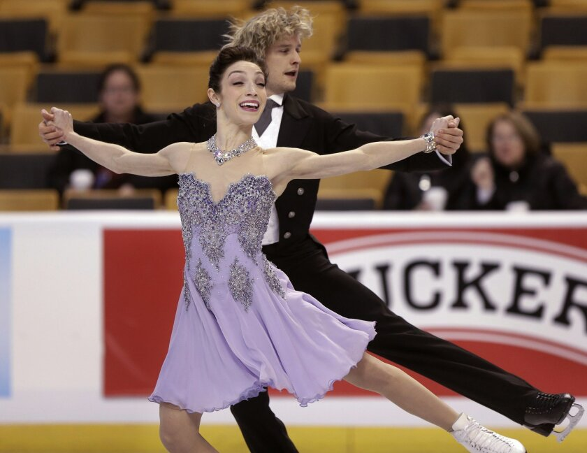 Meryl Davis, front, and Charlie White skate during practice at the U.S. Figure Skating Championships on Wednesday, Jan. 8, 2014, in Boston. (AP Photo/Steven Senne)