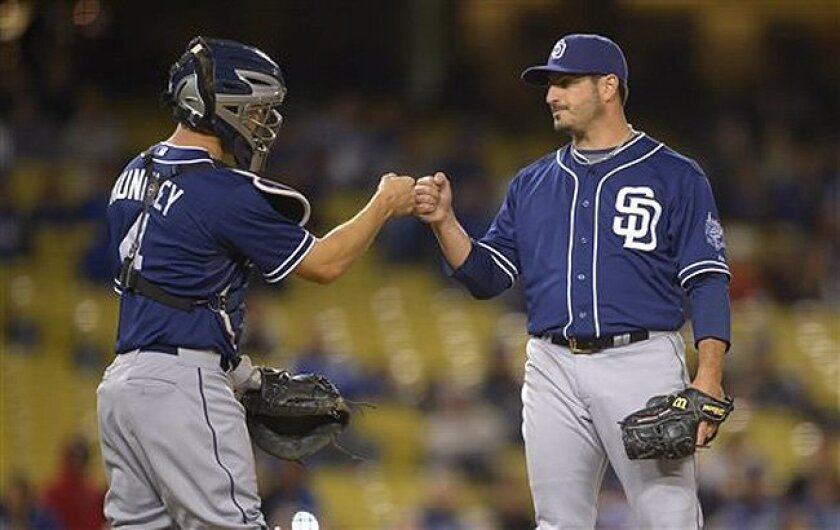 San Diego Padres starting pitcher Jason Marquis, right, is congratulated by catcher Nick Hundley as he is taken out of the game during the eighth inning of their baseball game against the Los Angeles Dodgers, Tuesday, April 16, 2013, in Los Angeles. (AP Photo/Mark J. Terrill) / AP