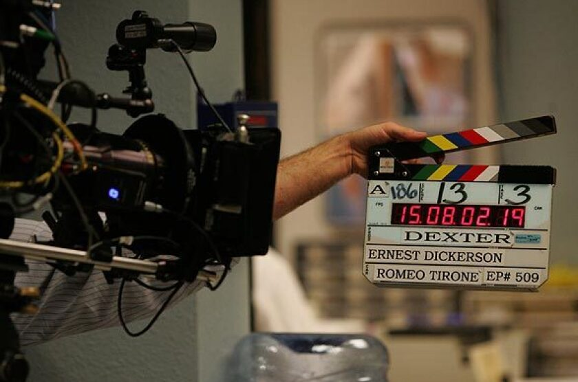 """A clapper marks the beginning of a scene during a long-ago taping of """"Dexter."""""""