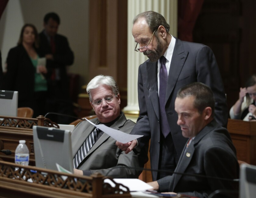 State Sen. Jerry Hill (D-San Mateo), center, discusses legislation with Sen. Andy Vidak (R-Hanford), left, and then-Sen. Steve Knight (R-Palmdale) in 2014.