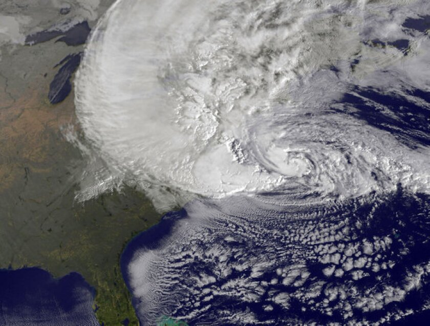 A satellite image provided by NASA shows Hurricane Sandy off the East Coast.