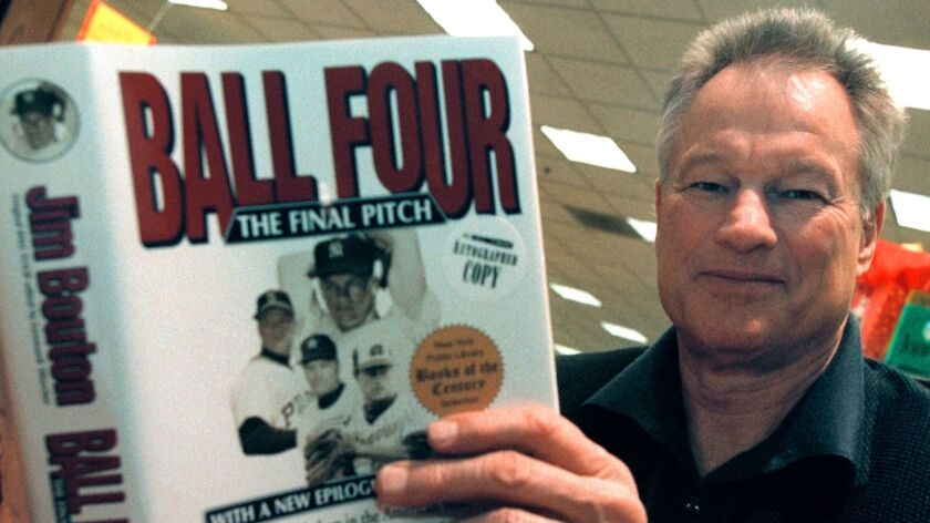 """Former major league pitcher Jim Bouton signs copies of his book, """"Ball Four: The Final Pitch,"""" in November 2000."""
