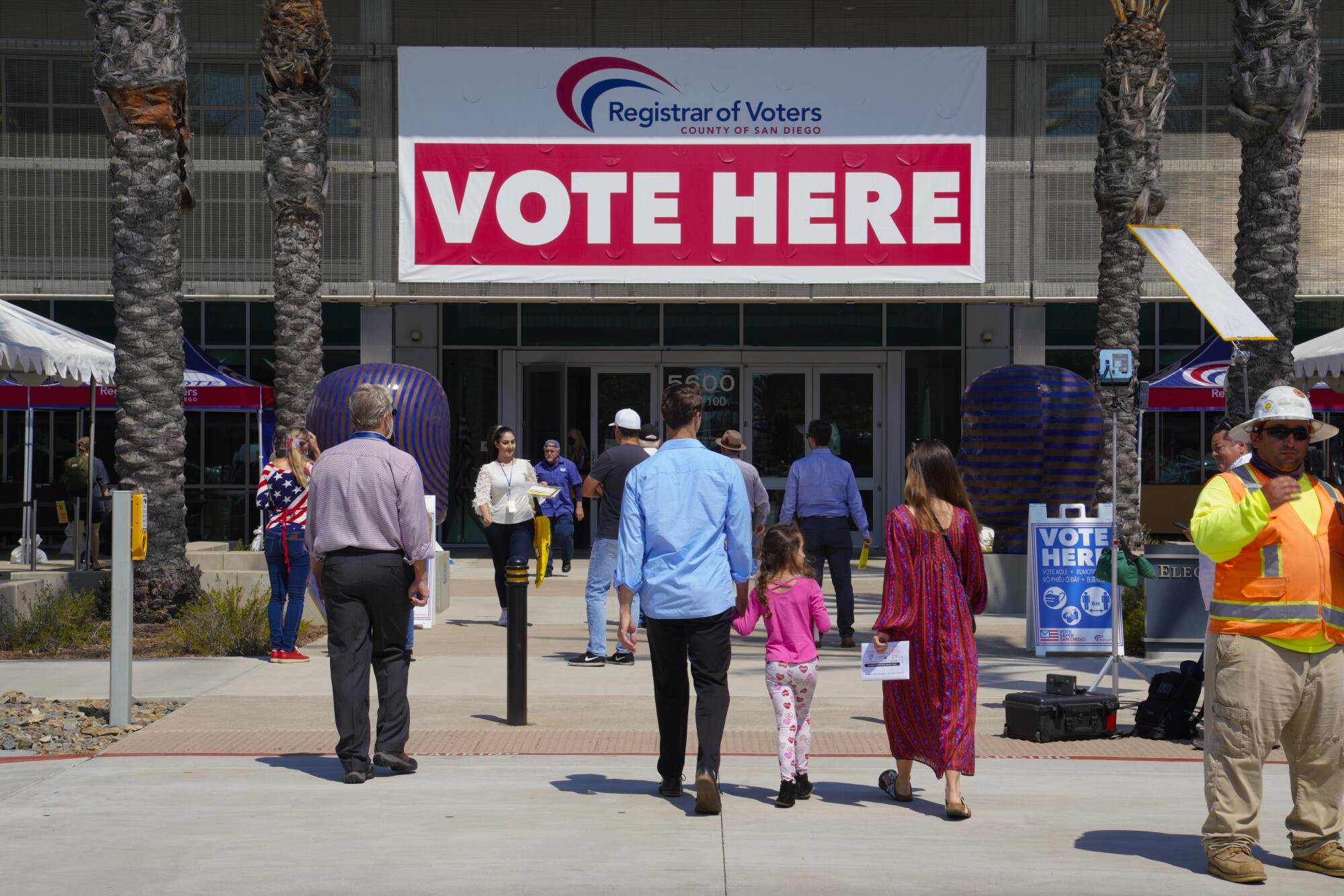 Voters arrive at Registrar of Voters office in on Kearny Mesa to cast their ballots on Tuesday.