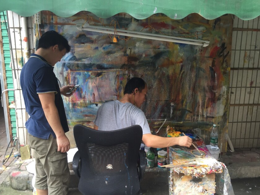 Artists work in Dafen Oil Painting Village in China.