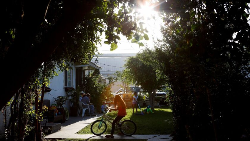 PARAMOUNT, CA: September 1, 2016 - Children play in the communal yard between apartments on Vermont