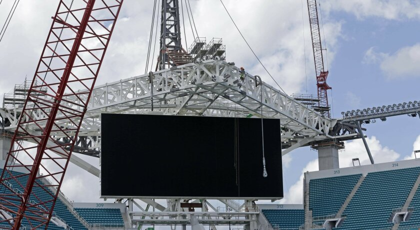 A large video screen is in place at the Miami Dolphins' NFL football stadium, which is undergoing renovations, Thursday, June 2, 2016, in Miami Gardens, Fla. The first game of 2016 is three months away, and the stadium is far from ready. But Dolphins officials say they're on schedule with a major r