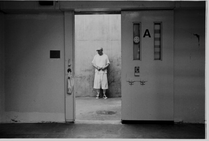 An inmate stands in the concrete exercise area of his solitary confinement unit at Pelican Bay State Prison.